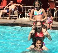 Mackenzie, Maddie, and Nia having fun at the pool