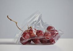 The plastic bag in this illustration is very well done. The highlights show the crinkling of the bag and you can even see the bag placment over the grapes