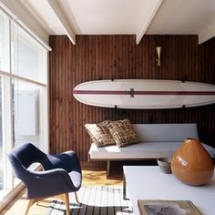 As a Floridian, surfboards can make the perfect art wall with a combination of woods and texture.