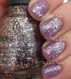 The PolishAholic: China Glaze Holiday 2014 Twinkle Collection  - Dancing & Prancing is a multicolored glitter topper.