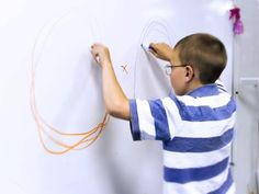 """Visual motor integration means the dominant sensory system, Vision, guides movement. In this example you see a long practiced vision therapy activity demonstrated called bi-manual circles. Here the fixation target is the central """"X"""". While looking directly at the """"X"""" our patient uses his """"side-vision"""" to create the bi-manual circles. The Awareness cue is the ability to see centrally and peripherally simultaneously. The Feedback cue is the quality of his circles made"""