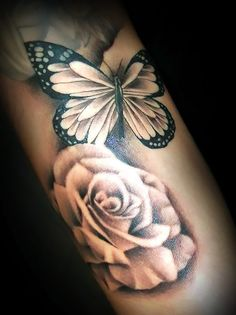 This perfectly shaded tattoo of a butterfly and roses represents life, freedom, love, new beginning and destiny. It is placed on arm.