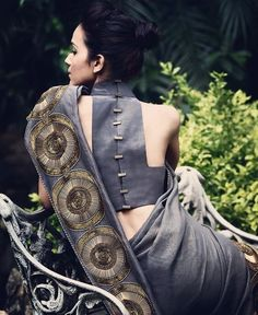 An interesting blouse back design can add an element of mystery to your saree outfit. With the option to get your blouse customized. Blouse Back Neck Designs, Sari Blouse Designs, Saree Blouse Patterns, Blouse Styles, Shagun Blouse Designs, Choli Designs, Saree Jackets, Indian Bridal Wear, Indian Wear