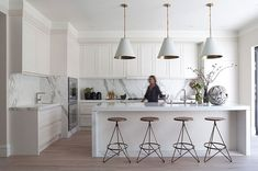 I like the whole look of this kitchen. Not sure I'd want to do all white again. like the stools, the lights