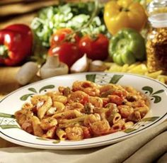 Shrimp Primavera contains shrimp. bell peppers, onions and mushrooms in an arrabbiata sauce over pasta.