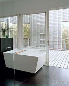 Whether minimalistic or luxurious, an outdoor shower always sets the tone for relaxation on a hot summer day.