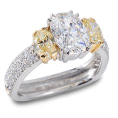 Classique Collection - 2.01ct Oval Diamond accented by two Yellow Oval Diamonds set in Platinum and 18K Yellow Gold.