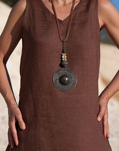 Ethnic brass necklace with clay bead and baule bead