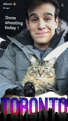 Omg! Can't decide who is cuter... the cat or Alberto? Can I take both home?