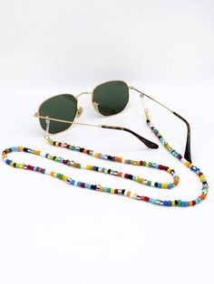 Sunnycords® are modern eyewear chains for your sunglasses. The Sunnycord® is a fashionable glasses cord for holding any kind of eyewear. Initially designed to never lose you glasses or reading glasses again. Shop your sunglass chain now online! Sunglasses Accessories, Eyewear, Reading Glasses, Beaded Bracelets, Chain, Pearl Jewelry, Eyeglasses, Fashion Fashion, Runway Fashion