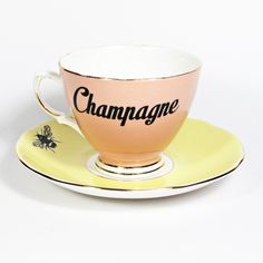 Cute 'Champagne in a Teacup' mismatching vintage teacup and saucer set with quirky Champagne and Bee designs applied and beautiful gilt gold detailing.This unique and rare vintage set has been hand made with love in London, England.Original piece of functional art. Washable (hand wash) and food/drink safe.Teacup measures approx- 8cm (3 inches) in diameter, 8cm (3 inches) high.Saucer measures approx - 14.5cm (5.5 inches) in diameter.Every item is thoroughly and safely...