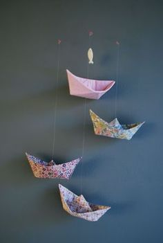 A cute idea might be to do a combination of cranes, boats and fish f8r a mobile.