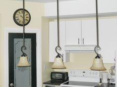 Pendant lights, black pantry door with frosted glass