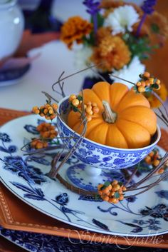 Autumn tea table setting --> love the colors! Would never have thought to use the blues for an autumn theme but it works!