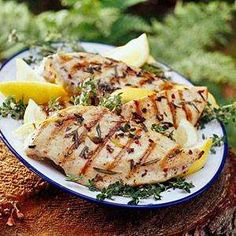 SizzlerLemon Herb Chicken f t p @ X z 2 skinless, boneless chicken breast halves 1 lemon salt and pepper to taste 1 tablespoon olive oil 1 pinch dried oregano 2 sprigs fresh parsley, for garnish