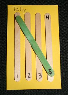 Teach tally marks in a concrete, tactile way with popsicle sticks. Make the 5th one a different color, intentionally. #tallymarks