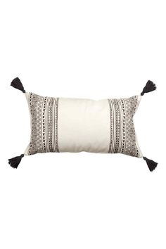 Cushion cover with tassels: Rectangular cushion cover in a patterned cotton weave with yarn tassels in the corners and a concealed zip.