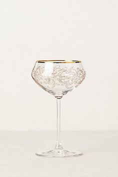 Gold etched champagne coupe glass.
