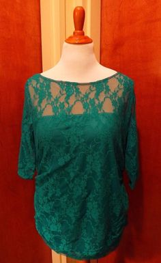 This green lace plus size top from Kiyonna is a top that lovers of the color green will want to have to wear!