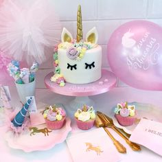 A photo of some of our unicorn partyware with a Unicorn cake made by our shop neighbour @libbygcakes. The unicorn balloon is one of our own designs. All items available online.