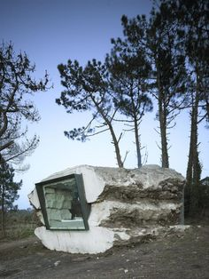 Minimalist Vacation Home is Fashioned Inside Concrete Rock.  The inhabitable concrete stone is located in Costa de Morte, Spain and was designed by Ensamble Estudio in collaboration with Ricardo Sanz and Javier Cuesta. Its 25 square-meter minimalist decor has everything you'd need for a peaceful getaway, and includes a raised platform bed, modest bath, and built-in fireplace. http://www.mymodernmet.com/profiles/blogs/the-truffle-ensamble-estudio