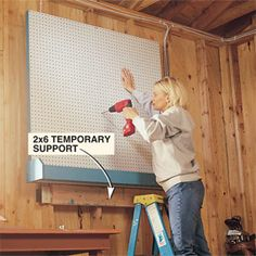 Pegboard is essential for efficient garage storage and adding a bin makes it even better.