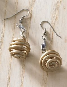 Metal Squiggle Earrings--This collection of squiggles and swirls displays the kind of effortless charm that provokes smiles. The formed polished aluminum is anodized, a process which ensures a durable sheen and lasting color.