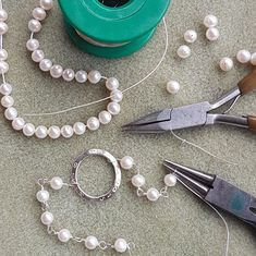 Linking each pearl with fine silver wire to make this personalised pearl bracelet.