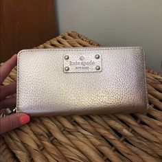 """Kate Spade Neda Wellesley Rose Gold Wallet BRAND NEW. Kate Spade Neda styled zip wallet Wellesley Rose Gold. Metallic leather with 14-karat light gold hardware. Zip around closure. Rear exterior zip pocket. Interior includes: 2 bill slip pockets, phone compartment and 12 card slots. Dimensions are approx: 7.75"""" (L) X 4"""" (H) X 1"""" (W). kate spade Bags Wallets"""