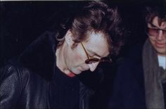 John Lennon gives an autograph next to his killer Mark Chapman just hours before his death.