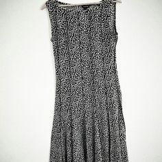 "Forever Unique sleeveless dress This is a higher end brand, NOT TO BE CONFUSED with Forever 21!! Black sleeveless w/ white dots. Fitted to waist, then flares. Ends at hem with a flouncey and feminine. Vertical piping, neck to hem. White coffee bean pattern. Poly spandex, stretchy fabric. So flattering! The size isnt legible on tag, but the dress appears to be a M. Absolutely excellent condition! See measurements for size. L= 43"" (from shoulder seam to hem), B=18""across, w= 15"", hips=18"". All…"