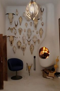 Wall of skulls and wood burning fire.
