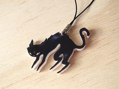 Black Cat Phone Charm. $4.00, via Etsy.