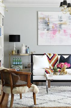 Shop the Look | My Decor Picks from Candelabra : tribal patterned adana throw blanket by happy habitat, gold piedmont vase by arteriors, black and white sofa, diamond shag rug, sheepskin, abstract art, large pineapple, library wall