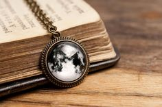 Tiny full moon brass pendant with glass dome. Chain included. The magnifying glass with printed picture is hand set in a pendant base.  Glass dome