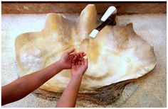 https://flic.kr/p/zajxfK | GIANT CLAM-SHELL SINK WITH A WOMAN'S HANDS FOR SCALE | Move over, SAM'S BY THE SEA --- your fantastic seafood restaurant down in Awase has some real competition in the Restroom department !   Your fabulous sinks made out of  Okinawa's huge clam shells are being seriously challenged by the Restrooms over at the SOUTHEAST BOTANICAL GARDENS just outside of Kadena Air Base.  In fact, we will probably have to get out our tape measures to see who takes the prize for the…