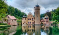 Mespelbrunn Castle is a medieval moated castle on the territory of the town of Mespelbrunn, between Frankfurt and Würzburg, built in a remote tributary valley of the Elsava valley, within the Spessart forest. Photo credit - Stefan Skalla