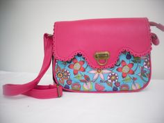 Jungle Boom red shoulder bag This handbag is soft and colourful like a tropical rainforest. There is a zipped external pocket on the back and a front compartment. Dimensions: Length: 27cm Width: 8cm Depth: 21cm Strap max length 140cm £32.50