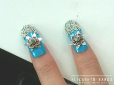 Nails on elizabeth banks (Effie trinket) from the hunger games. They said it took 45 minutes a DAY to do her nails!