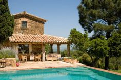 Tiled roof over patio by pool. Stone house. Great view. I'm there.