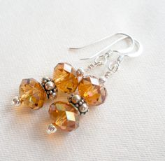 sterling silver crystal earrings 8mm copper briolette swarovski crystal amber on Etsy, $15.00