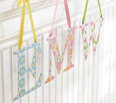 Seems like these would be easy enough to make with wood letters, spray adhesive, modge podge and scrapbook paper.