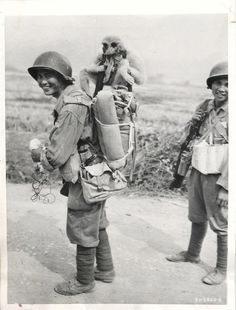 1945- Monkey catches a ride on the pack of a Chinese infantryman as Allied troops continue offensive in Central Burma.