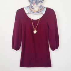 """Holiday Sweater This cute burgundy sweater is made of soft thick material perfect for the holidays. It is in good used condition and has some pilling under the sleeves but is barely noticeable when worn. Color is most accurate in last photo. The top is fitted through the body and has cute puff 3/4 length sleeves. Measures 14"""" pit to pit un stretched and 25"""" long from shoulder to bottom. 50% viscose 30% cotton 17% nylon and 3% spandex. Fabric has a generous amount of stretch. Forever 21 Tops"""