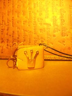 Mini leather book pendant with little golden crown