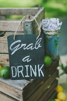 "Rustic chalkboard ""Grab a Drink"" sign. #refresments #weddingdecor #beverages #chalkboard http://www.weddingchicks.com/2013/11/04/family-style-wedding/"