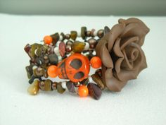 Orange Day of the Dead Skull with Brown Polymer by OctoberPetals