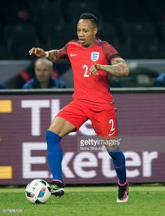 Nathaniel Clyne of England runs with the ball during the International Friendly match between Germany and England at Olympiastadion on March 26 Nathaniel Clyne, Football Photos, Germany, March, England, Stock Photos, Running, Sports, Pictures