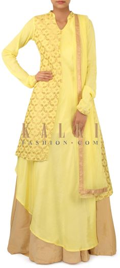 Yellow suit matched with beige lehenga only on Kalki