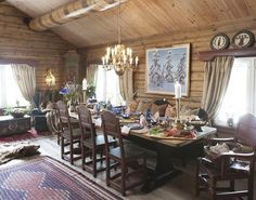 mountain cabin interior design   Neat mix of items in this dining room, have not seen a beam like that before. Painted? Like the dark, oxblood red and pine green together.